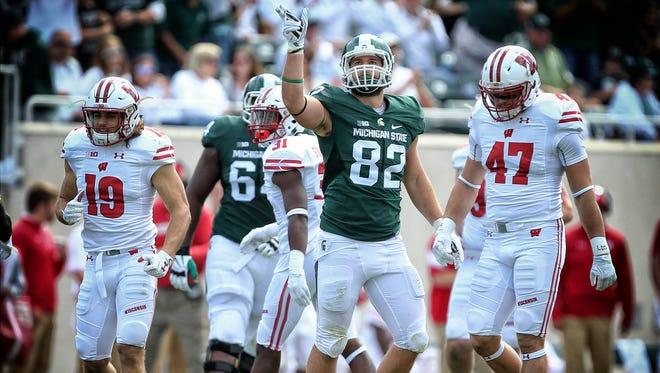 Michigan State tight end Josiah Price gestures a first down during the Spartans' 30-6 loss to Wisconsin on Sept. 24. Price has 14 catches and two touchdowns this season.