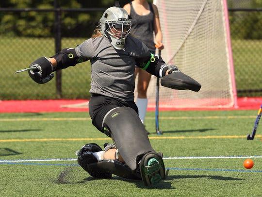 Chatham senior goalkeeper Abby Walrond tries to block