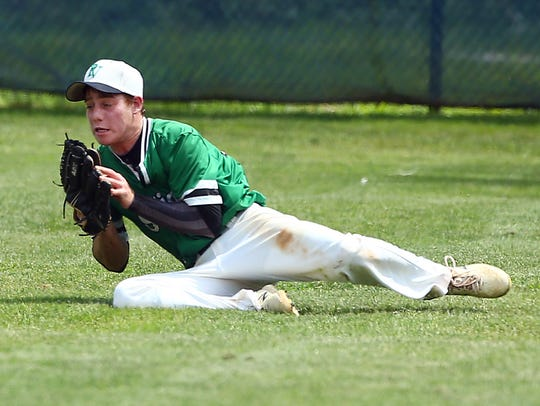 Pascack Valley outfielder Ryan Novakowski makes one of his two sliding catches against Roxbury in Friday's North 1, Group 3 baseball final.