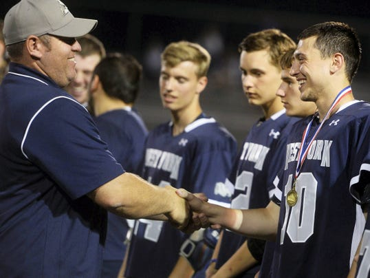 West York's Hunter Betz shakes the hand of head coach Rodney Tamblin, left, after the Bulldogs beat Susquehannock to win the YAIAA tournament championship in May. Betz said winning the league title was the team's goal for the season. He was named GameTimePA.com boys' lacrosse Player of the Year.