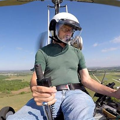 Doug Hughes in his gyrocopter last month.