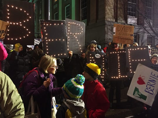 A mix of protesters and spectators, some with their kids, gather by the hundreds outside of the Flynn Center in downtown Burlington Thursday night, January 7, 2015, while GOP presidential candidate Donald Trump spoke at the venue.
