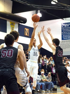 Dre Norman takes a 3-pointer in the first quarter during