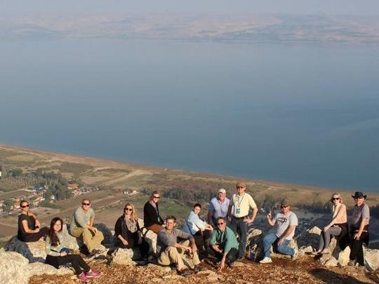 This photo is taken from atop the Arbel Cliffs and shows the Sea of Galilee in the background. Audrey Weidner is shown at left, P.J. Weidner is third from left, Teresa Spiess is fourth from left, Brian Spiess is sixth from left, and Amy and Simon Sapsford are at right.