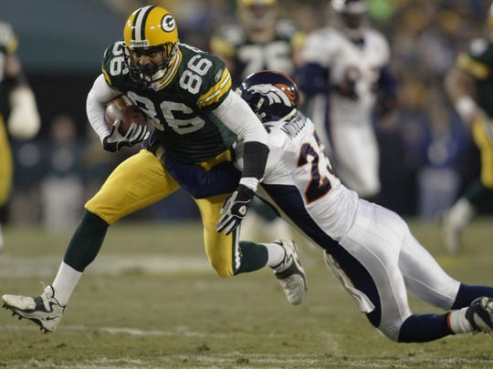 Green Bay Packers'  Antonio Freeman, shown in a 2003 game against the Denver Broncos, is taking part in the Packers Tailgate Tour, which comes to the UW-Milwaukee Panther Arena Friday.