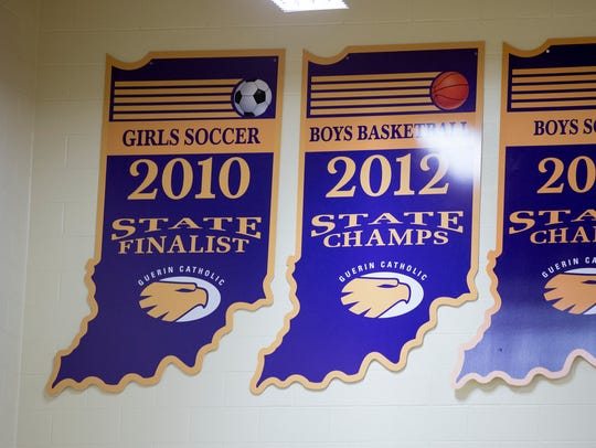 "Guerin soccer player Megan Wampler is tired of seeing these banners hanging in  the gym at Guerin Catholic High School in Noble. ""I want to see a girls state champion up there, and I'm not the only one."""