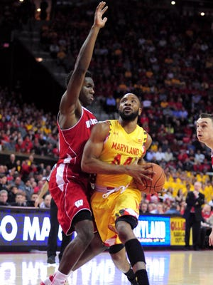 Maryland Terrapins guard Dez Wells (44) is defended by Wisconsin Badgers forward Nigel Hayes (10) in the second half at Xfinity Center.