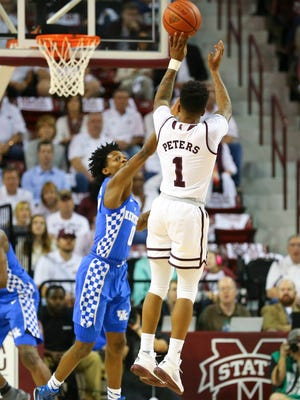 Mississippi State Bulldogs guard Lamar Peters shoots the ball against Kentucky Wildcats guard De'Aaron Fox during the first half Tuesday. Peters led all scorers with 25 points.