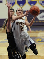 Unioto's Carly Adkins jumps up for a shot during Unioto's