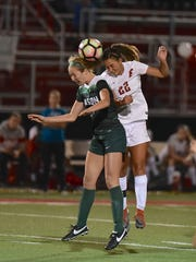 Fairfield's Alexis Goins gets her head to a ball against