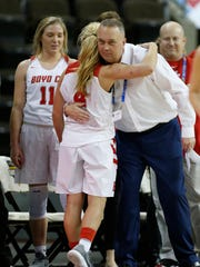 Boyd County's Savannah Wheeler hugs her coach at a 2018 state tournament game.