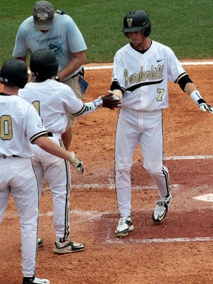 Vanderbilt's Dansby Swanson (7) celebrates with teammates after hitting a two run homer during the first inning of a game against Missouri at the Southeastern Conference college baseball tournament at the Hoover Met, Wednesday, May 20, 2015, in Hoover, Ala. (AP Photo/Butch Dill)