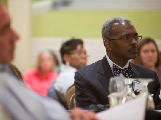 Delaware Center for Justice Board member, Walter Matthews, listens to guest speaker Alec Karakatsanis, Co-founder of Equal Justice Under Law, speak at the Visions of Justice 2015 conference at the Hilton Wilmington/Christiana.