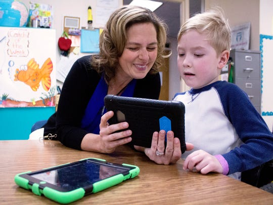 April Moran, a teacher at Cormier School and Early Learning Center, works with Joey Steffek on a math lesson. Moran is one of seven 2018 Golden Apple award winners.