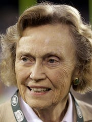 Betty Wold Johnson, mother of New York Jets owner Woody Johnson, smiles on the sideline prior to the start of an NFL football game between the Jets and the Dallas Cowboys Sunday, Sept. 11, 2011, in East Rutherford, N.J. (AP Photo/Julio Cortez)