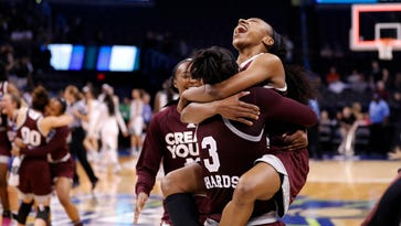 Mississippi State's Morgan William, right, celebrates with Breanna Richardson (3) after a regional final of the NCAA women's college basketball tournament against Baylor, Sunday, March 26, 2017, in Oklahoma City. Mississippi State won 94-85. (AP Photo/Alonzo Adams)