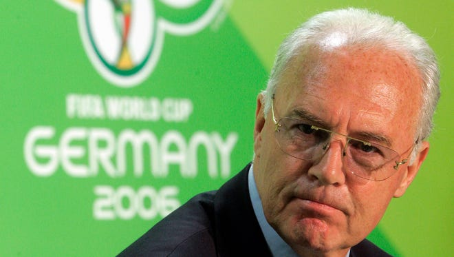 """In this June 29, 2006 file photo Franz Beckenbauer, then president of the German Organization Committee of the soccer World Cup briefs the media during a news conference at the Olympic Stadium in Berlin. Swiss federal prosecutors say they are conducting an """"ongoing operation"""" in an investigation of the 2006 World Cup organizing committee as part of a wider probe of corruption linked to FIFA."""