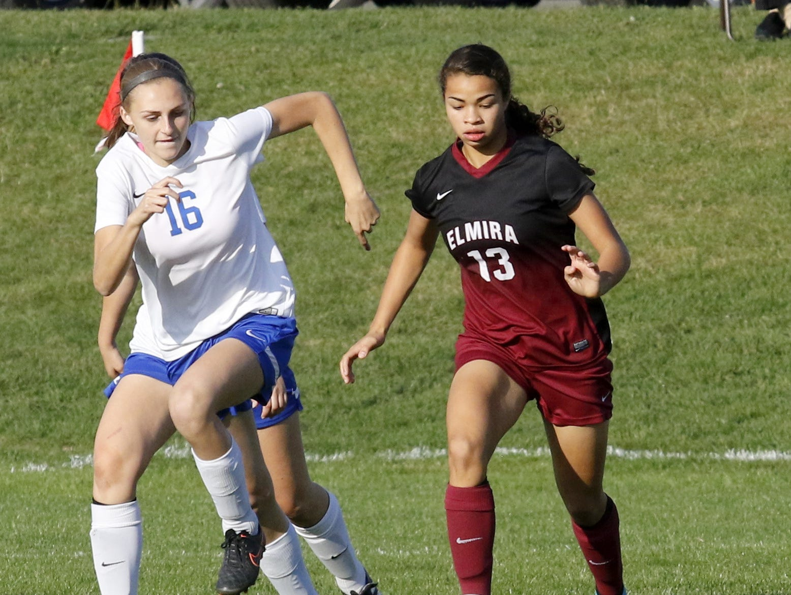 Kendra Oldroyd of Elmira controls the ball as Emily Leland of Horseheads defends Thursday during the teams' 1-1 girls soccer tie at Horseheads.
