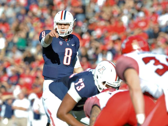 Nick Foles leads the Arizona Wildcats offense in 2011.