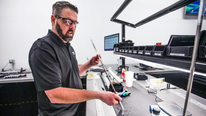 Parsons Xtreme Golf master club builder Thomas Hays works his craft at the company headquarters in Scottsdale, Monday, December 5, 2016.