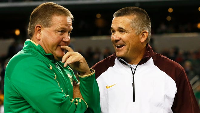 Notre Dame head coach Brian Kelly talks to Arizona State head coach Todd Graham before the game on Saturday, Oct. 5, 2013 at AT&T Stadium in Arlington, TX