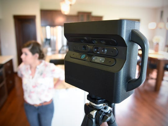 A Matterport 3-D camera is used to create virtual walk-through images of homes for online real estate advertisements.