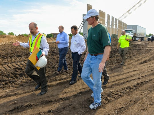 Tim Gillet, left, senior architect with HMA Architects, talks with St. Joseph Mayor Rick Schultz, right, Tuesday, June 7, as they tour the new St. Cloud Area YMCA Community & Aquatics Center site.