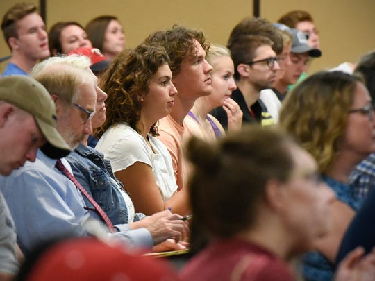 The audience listens to speakers during a panel discussion during the Peace Studies Conference Tuesday, Sept. 12, at the College of St. Benedict.