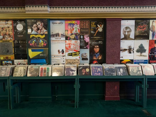 Records and memorabilia line the walls inside State