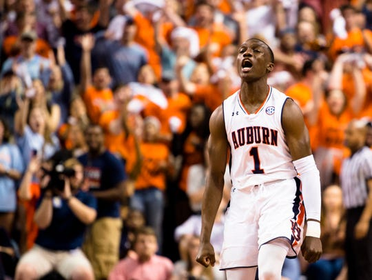 Auburn Tigers guard Jared Harper (1) celebrates after