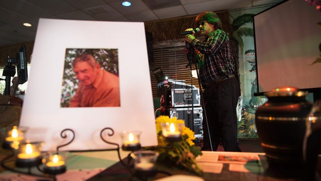 Paul Taylor sings a song dedicated to his friend Lynn Brown during a celebration of life for Brown at Sneaky Pete's in Bonita Springs on Aug. 28, 2016. Brown, who attended karaoke at the bar every Monday and Tuesday night, was killed in an apparent hit-and-run earlier this month.