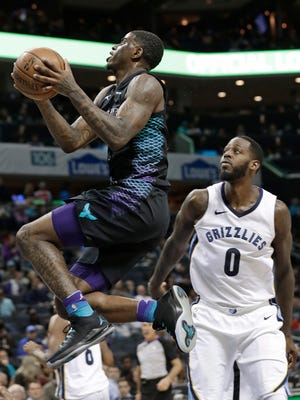 Charlotte Hornets' Dwayne Bacon, left, drives past Memphis Grizzlies' JaMychal Green, right, during the first half of an NBA basketball game in Charlotte, N.C., Thursday, March 22, 2018. (AP Photo/Chuck Burton)