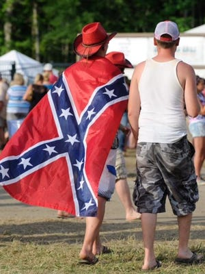 A country music fan wears a Confederate flag at the Big Barrel Country Music Festival on Friday.