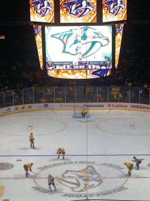 Predators await the opening face off with the Pittsburgh Penguins on Saturday night at Bridgestone Arena in Nashville.