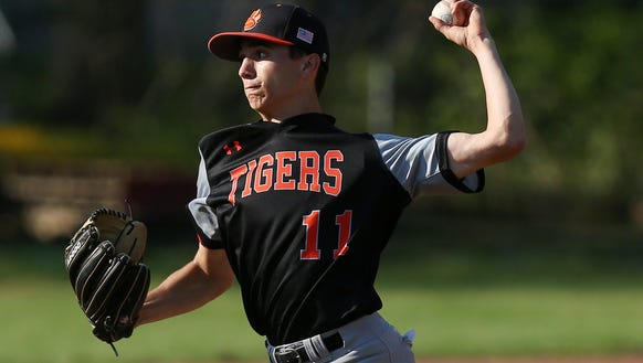 White Plains pitcher Michael Attonito (11) in action