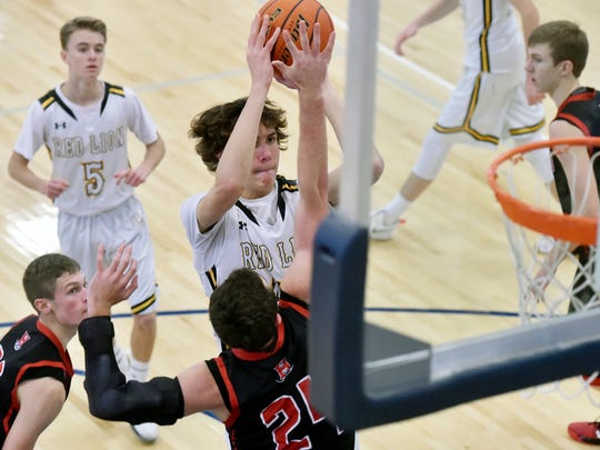 Red Lion's Brock Gould shoots against Hempfield's Bryan Karl in the second half of a boys' basketball game in the War of the Roses showcase Saturday, Jan. 7, 2017, at West York. Red Lion lost 54-35 to Hempfield in one of the showcase's six games pitting the YAIAA against Lancaster-Lebanon schools.