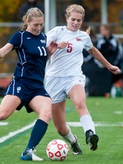 CVU's Paige DuBrul, right, and Burlington's Callie Flynn try to get a foot on the ball during the Division I state championship in Burlington earlier this month.