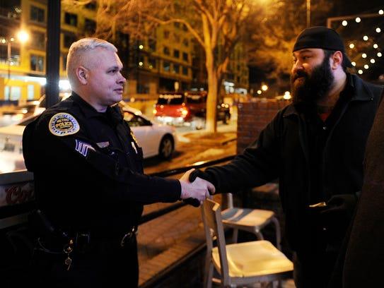 Metro Police Sgt. John Pepper walks down Demonbreun