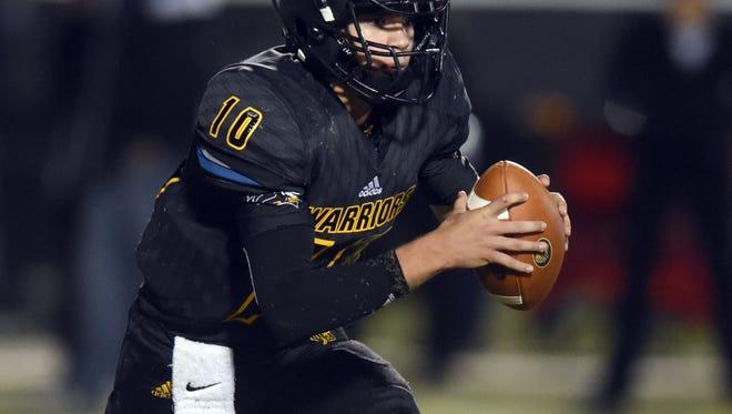 Oak Grove quarterback John Rhyes Plumlee runs the ball against Brandon High School on Friday at Oak Grove High School.