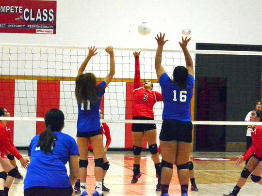 Loving's Cassandra Calderon gets a kill in the first set Monday.