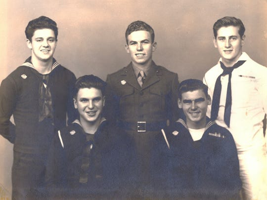 A 1946 photo of World War II veterans who grew up as friends in South Camden: (back row, from left) Navy sailor Charles Kimley, Marine Howard Pearce and Navy sailor Joe Miles; (front row, from left) Navy sailor W. Thomas Parker and William F. Schorpp. Schorpp's name is missing from the World War II monument on Broadway in Camden, and Joe Miles has waged a one-man campaign to get the oversight corrected.