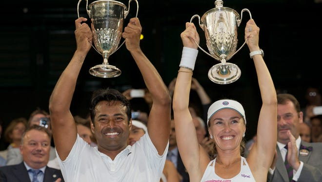 Martina Hingis and Leander Paes celebrate their mixed doubles title.