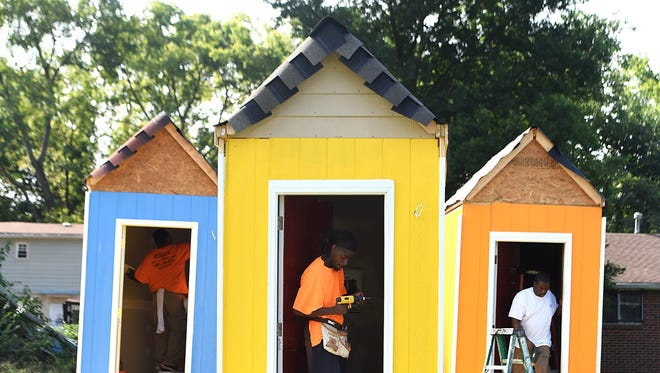 Construction workers build micro homes for the homeless. A Nashville interfaith congregation exceeded its $50,000 fundraising mark last week and has spent the better part of this one building a village of six micro homes for the homeless.