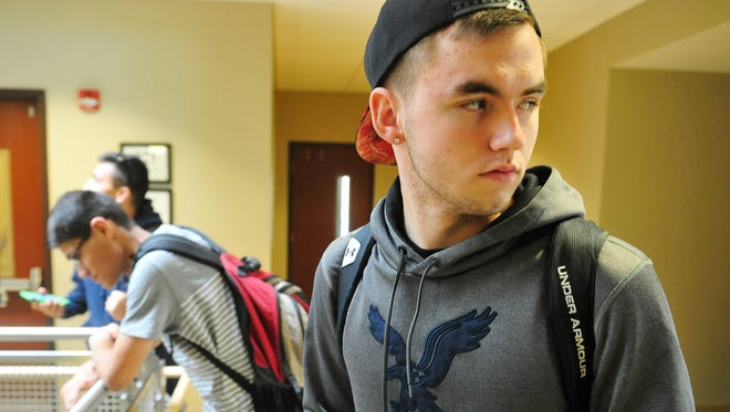 Justin Short waits in the hall to go to his writing class at Northeast State Community College.