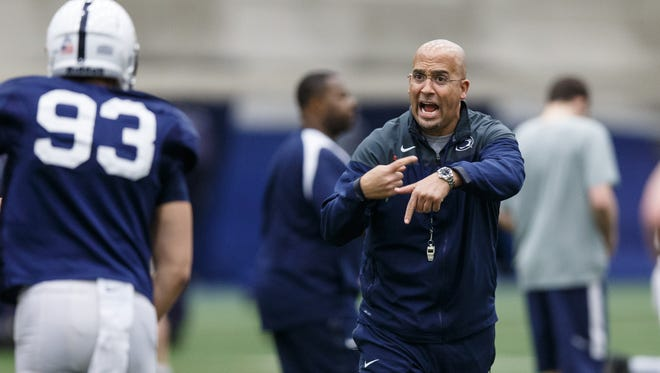 Penn State coach James Franklin gives orders during the NCAA college football team's spring practice Wednesday, April 1, 2015, in State College, Pa.