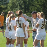 New Lansing girls' soccer coach Ken Kutler works with his team during a scrimmage Saturday afternoon.