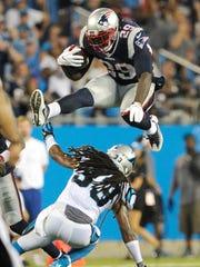 New England Patriots' LeGarrette Blount leaps over