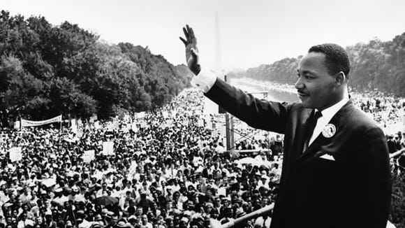 """28 Aug 1963, Washington, DC, USA --- Reverend Martin Luther King, Jr. waves to participants in the Civil Rights Movement's March on Washington from the Lincoln Memorial. It was from this spot that he delivered his famous """"I Have a Dream"""" speech on August 28, 1963. --- Image by © Hulton-Deutsch Collection/CORBIS"""