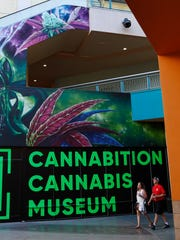 People walk by the Cannabition cannabis museum in Las Vegas.