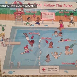 A Red Cross pool safety posted that some have called racist.